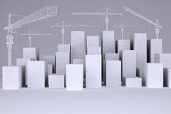 White cubes with wire-frame tower cranes Stock Image