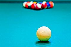 White cue ball close-up on a pool table covered Stock Photo
