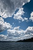 White Cumulonimbus cloud in blue sky at sea. Royalty Free Stock Photo