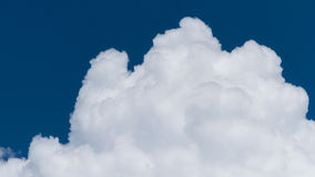 White cumulus cloud on blue sky Stock Images