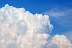 White Cumulus cloud on a blue sky closeup royalty free stock photography