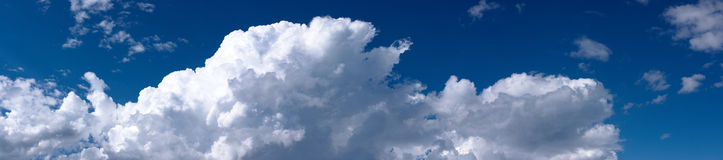 White cumulus clouds. Big white cumulus cloud formation, panoramic stock images