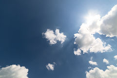 White cumulus clouds against a blue sky. Stock Images