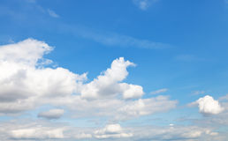 White cumulus clouds in blue autumn sky Stock Photos