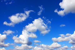 White cumulus clouds and  blue sky. Stock Images
