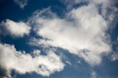 White cumulus clouds in blue sky stock photo