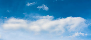 White cumulus clouds in the blue sky for Stock Images