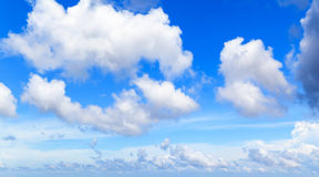 White cumulus clouds in blue sky at day Stock Photos
