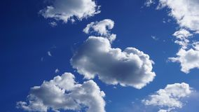 White cumulus clouds in blue sky. Spring time royalty free stock images