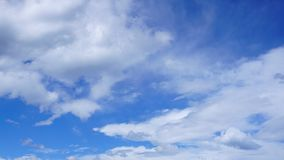 White cumulus clouds in blue sky. Spring time stock photography