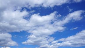 White cumulus clouds in blue sky. Spring time royalty free stock photos