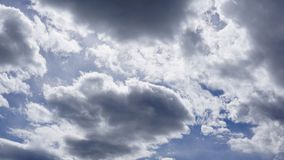 White cumulus clouds in blue sky. Spring time royalty free stock photography