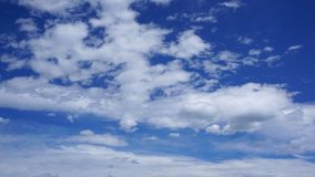 White cumulus clouds in blue sky. Spring time royalty free stock photo