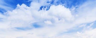 White cumulus clouds in blue sky Stock Image