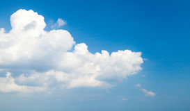 White cumulus clouds in deep blue sky. Natural photo background Stock Photos