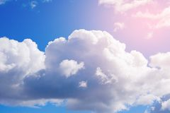 White Cumulus clouds in a free idyllic blue sky on a Sunny summer day, close-up stock photography