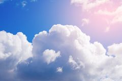 White Cumulus clouds in a free idyllic blue sky on a Sunny summer day, close-up royalty free stock photo