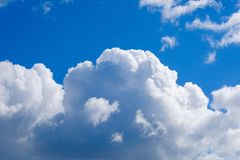 White Cumulus clouds in a free idyllic blue sky on a Sunny summer day, close-up stock images
