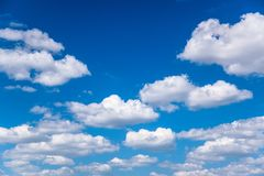 White cumulus clouds. In good sunny weather stock photo