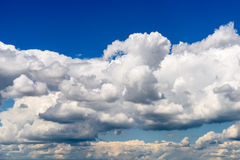 White Cumulus Clouds And Grey Storm Clouds On Blue Sky Royalty Free Stock Photos