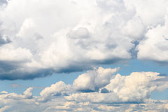 White Cumulus Clouds And Grey Storm Clouds On Blue Sky Stock Image