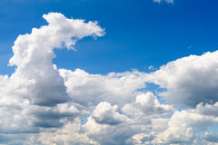 White Cumulus Clouds And Grey Storm Clouds On Blue Sky Stock Photos