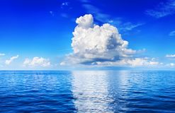 Free White Cumulus Clouds In Blue Sky Over Sea Landscape, Big Cloud Reflection On Water Above Ocean Panorama, Scenic Tropical Seascape Royalty Free Stock Image - 163695456