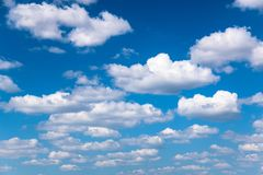 White cumulus clouds. In good sunny weather royalty free stock photo
