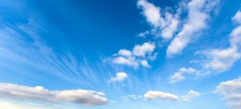 White cumulus clouds. In good sunny weather royalty free stock image
