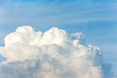 White cumulus congestus clouds on blue sky background. Vibrant outdoors horizontal image with copy space Stock Images