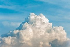 White cumulus congestus clouds on blue sky background. Vibrant outdoors horizontal image with copy space Stock Photography