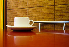 White cup. On the red table in a cafe Royalty Free Stock Images