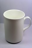 White Cup. In white background stock images