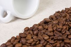 White cup, beans at textile Royalty Free Stock Photography