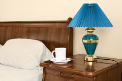 White cup on a bedside table Royalty Free Stock Photos