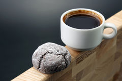 White Cup of black coffee with biscuits on a wooden frame Royalty Free Stock Image