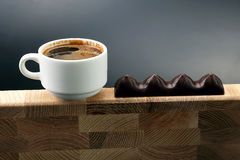 White Cup of black coffee with chocolate on a wooden frame Stock Photography