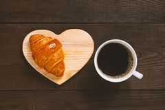 White cup of black coffee with fresh croissant royalty free stock photo