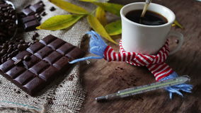White cup of black coffee in scarf stock footage