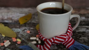 White cup of black coffee in scarf stock video footage