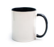 White cup with a black handle Stock Photos