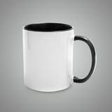 White cup with a black handle Stock Photo