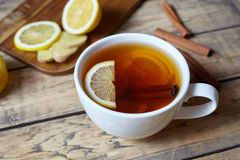 White cup of black natural tea with ginger, lemon and honey. Healthy Antiviral drink. Hot winter beverage concept. Stock Photo