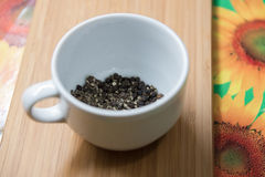 White cup of black pepper Stock Images