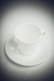 White cup  with black vignette retro filter Stock Photography