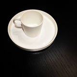 White cup on a black wooden table Royalty Free Stock Photo