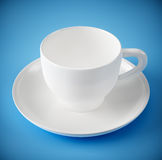White cup on blue background Stock Image