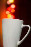 White cup on bokeh blur background, white cup, celebrate, Valentine's day. Royalty Free Stock Photos