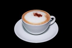 White cup of cappuccino coffee in black background Stock Images