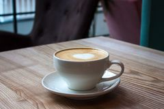 White cup of cappuccino stock images